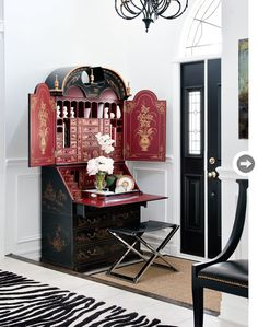 The secretary at this front door is unexpected and interesting. {Photography by Donna Griffith} interior, desk space, work desk, black doors, contemporary homes, small space decorating, writing letters, style at home, secretary