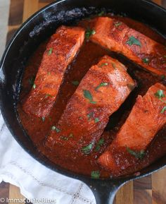 Quick and flavorful salmon smothered in a spicy tomato sauce. Perfect Weeknight meal served with vegetables or rice