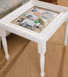 Photo frame accent table. Maybe use a large frame, shorter legs, and a thick plexi instead of glass for a full coffee table?