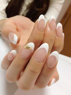 French manicure and gold. Could be an inspiration for many looks, imagine if the gold wasnt a word but a golden line between the white and pink - thatd be another good look! :)