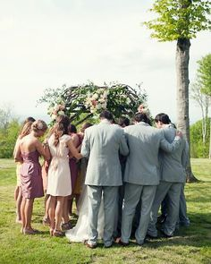 bridal party encircling the bride and groom for a time of prayer.  Excellent!