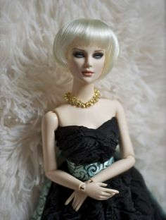 "@Alison Rasmussen 's ""Ultimate Glamour BJD Ashleigh"" : a Two Daydreamers exclusive resin fashion doll. Here, she is wearing a wig by Kemper, outfit by Jennygrey Designs, and jewelry from Royale number82.""    She is quite posh in this photo. A beautiful doll."
