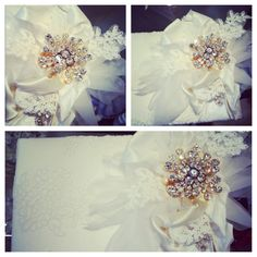 Creative Touch custom made swarovski crystal brooch adorned guestbook !Beautifulwhite lace was used to create an elegant and chic bridal look. Along with the luxurious silks and chiffon, a delicate flower was created to host the luxurious custom brooch. An all white color scheme with lots of sparkle!