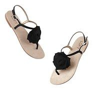"sooooo cute!   Viola Flower Sandals - Garnished with a sweet rosette for girly charm, this pretty pair is an adorable have-to-have. Adjustable buckle strap with elastic inset. Light traction at sole. 1/4"" heel."