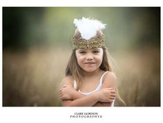 Great Gatsby flower girl in the rain - feathers, lace and crystal headpiece for girls for small and not so small. www.returntoeden.co.nz Photograph by Clare Gordon Photography www.claregordonphotography.com