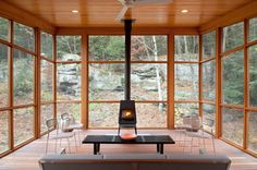 3-season porch of a Woodstock, NY second home, Wittus shaker woodstove | Hall Smith Office Architecture & CWB Architects, Brooklyn