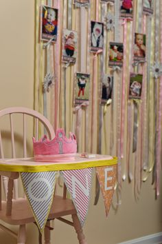 Adore the ribbon backdrop featuring pictures from baby's first year right by the #smashcake zone! #firstbirthday