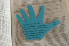 Trace your child's hand and write a verse in it to pray through out the year. Love this idea!