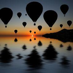Hot air balloons at sunset.