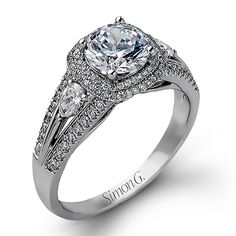 Delicate Collection - This gorgeous 18K white engagement ring is comprised of .37ctw round white Diamonds and .20ctw pear shaped Diamonds.  - MR1506-D