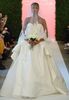 GORGEOUS ball gown with lace appliques and a draped bustle. Oscar de la Renta Spring 2015   MCV Photo   The Knot blog