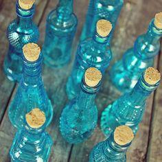 Small blue vintage-style bottles with cork stoppers. Get yours here: http://www.lightsforalloccasions.com/p-4742-vintage-glass-bottles-with-corks-assorted-5-inch-set-of-10-blue.aspx #vintagebottles #vintagedecor #vintagewedding