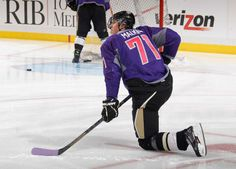 Evgeni Malkin of the Pittsburgh Penguins wears a #HockeyFightsCancer jersey during warm ups.