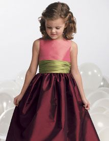 Flower girl dresses - top and bottom same rich purple and the sash that green.