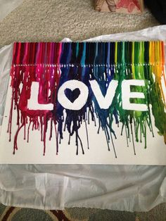 Crayon art!!! Love is for a play room art center, saying creativity grows here or something cute like that.