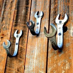 bent wrenches mounted as wall hooks add a