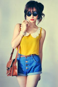 Really like the look of a collared tank top. Longer shorts.