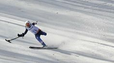 Stephanie Jallen of the U.S. brakes after crossing the finish line during the women's standing skiing Super G at the 2014 Sochi Paralympic W...