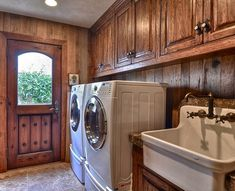 Amazing rustic laundry room with a farmhouse sink.