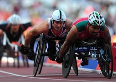 Great Britain's David Weir (centre) during the Men's 1 Mile during the Sainsburys International Para Challenge at the Olympic Stadium, London. Picture: Adam Davy/PA Wire
