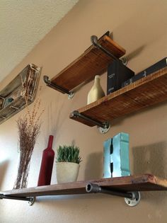 Industrial #Floating #Shelves. Use rough cedar planks and plumbing fixtures. #diy industrial floating shelves, decorating floating shelves, cedar shelving, cedar plank, float shelv, cedar shelves, bar shelves diy, floating shelves diy, diy floating shelves