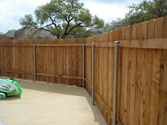 privacy fence with metal posts and wooden picket