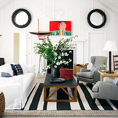 Designer Jeffrey Alan Marks used board and batten on the walls of this Nantucket beach cottage to give it a more modern feel. | coastalliving.com