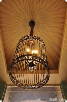 DIY:  Birdcage Chandelier Tutorial - Restoration Hardware's Birdcage Chandelier was  $2300!  This blogger made hers for $60, using a repurposed metal birdcage!