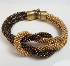 Love Knot Kumihimo Beaded Infinity Bracelet in Black and Gold - NOT A TUTORIAL, JUST AN IDEA