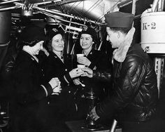 WAVES officers having coffee while touring a blimp at Naval Air Station, Lakehurst, New Jersey, United States, date unknown (United States National Archives)