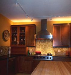 orange kitchen! http://orangekitchendecor.siterubix.com/ Great use of lighting in this orange kitchen  #ppgorange