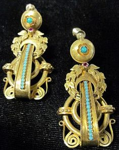 Fine yellow gold drop Turquoise earrings with applied laurel leaf, turquoise and ruby accent.    Fine yellow gold drop earrings