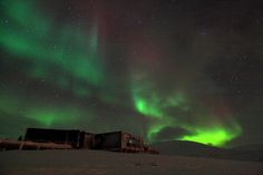 This shows an aurora appearing in the night sky at the Kjell Henriksen Observatory in Svalbard, Norway. Taken November 2010.  Credit: Njaal Gulbarndsen