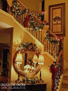 Staircase Christmas Decorating - note stockings hanging from railing. very personal in style.. love it!