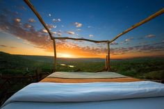 Enjoy a panoramic view of the sky and stars from you bed at the Loisaba Wilderness in Laikipia, Kenya.