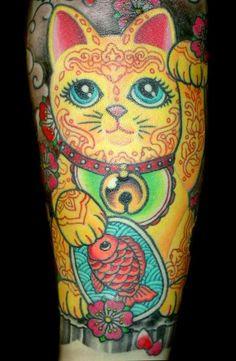 waving cat tattoo