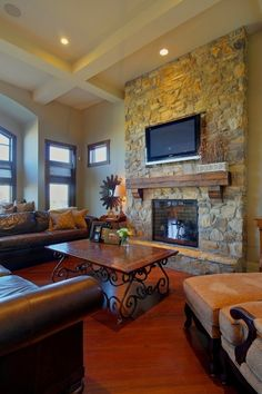 Like our stone wall... love the beams, mantel, and recessed lighting