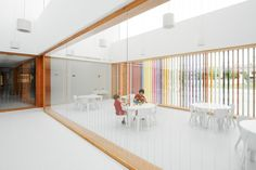Nursery School in Berriozar / Javier Larraz + Iñigo Beguiristain + Iñaki Bergera. Skylights light the internal spaces. Wooden framed windows and doors frame the spaces.