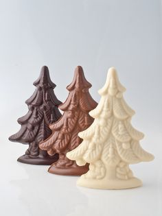 Solid chocolate Christmas Trees, available in white, milk, or dark chocolate.
