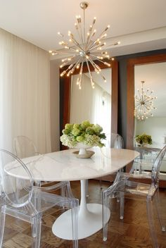 sputnik chandalier, ghost chairs and knoll tulip table.. perfffecto