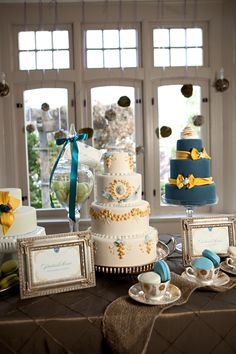 yellow and blue wedding cakes