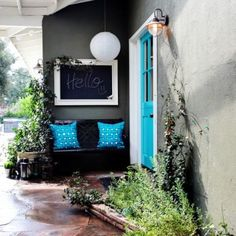 Use bright turquoise front door (& accents) to add life to a gray house with white trim!