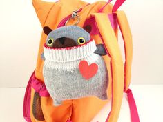 Cozy-up that backpack with a sockbear key ring.