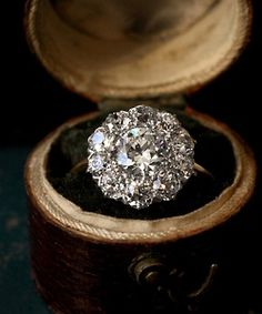 untraditional engagement ring: vintage Edwardian style ring in its vintage case.  Reminds of me of Christine Dae's engagement ring in the Phantom of the Opera!