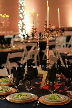 Wedding table setting.  Navy and gold.