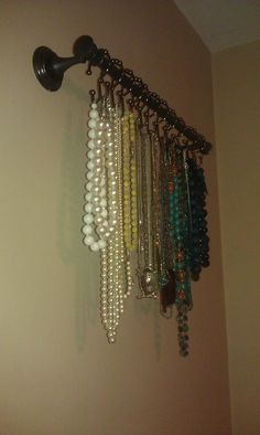 Towel rod with curtain shower hooks = jewelry holder.