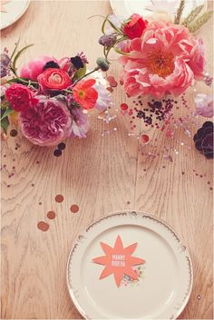 Kindof loving the metallic round confetti on the table... to tie in the sequin wall!