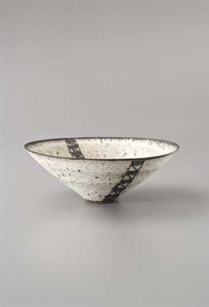 Lucie Rie: bowl, Stoneware, grey speckled glaze with manganese lip and a textured band through the well, the design repeated on the outside of the body. 26.5 cm. (10 3/8 in.) diameter, c.1978