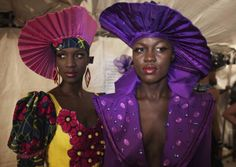 Models Diarra Thiam (L) and Sachakara Dieng wear creations by Senegalese designer Mamata Lopy backstage during the 10th anniversary of Dakar Fashion Week. Photo: Reuters