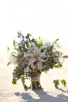 Beach wedding bouquet with air plants and berries | Brides.com